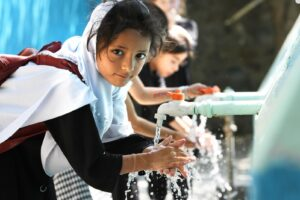 Students Washing Their Hands in School