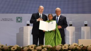Razia Alam, Chairperson, Maleka Welfare Trust, Bangladesh is presented an Aga Khan Award for Architecture 2019 certificate for the Arcadia Education Project, South Kanarchor, Bangladesh.